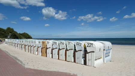 Many beach chairs stand side by side on the long, fine sandy beach on the Baltic Sea in Hohwacht, Schleswig-Holstein, Germany, Europe Zdjęcie Seryjne