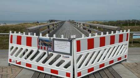 March 19, 2020, Heiligenhafen, Schleswig-Holstein, Germany, Europe. Closure of the pier. (Text is in German, means: Pier is currently closed to contain the coronavirus. We ask for your understanding)