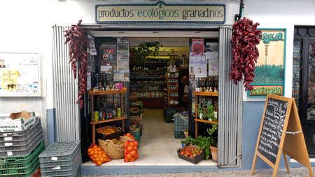 22 February 2018 Granada, Spain Europe: Open entrance of a small grocery store with ecological products in the old town of Granada.
