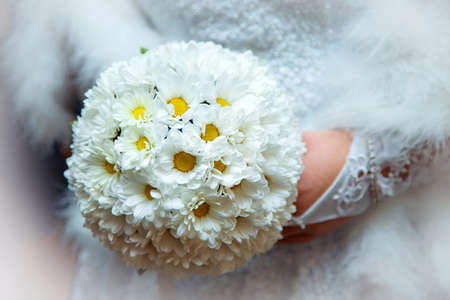 Beautiful wedding bouquet of white flowers the bride holds Stock Photo