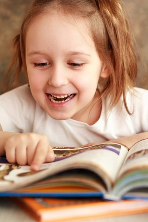 Smart girl reading a book and learns