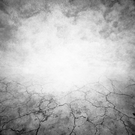 cracked earth: grunge background with space for text Stock Photo