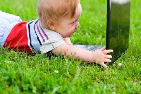 baby at the computer on the nature Stock Photo - 10790735