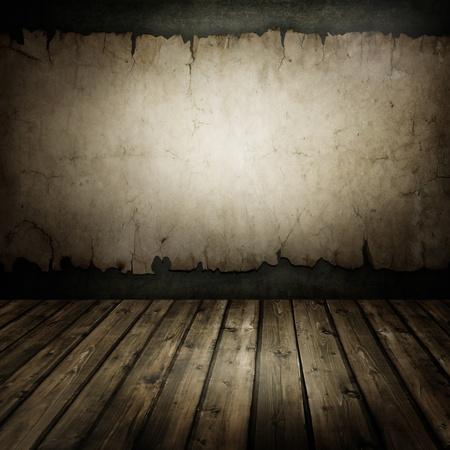 Zimmer mit einer alten Mauer und Holzboden