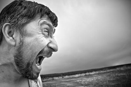 an aggressive angry man screaming Stock Photo - 10791221
