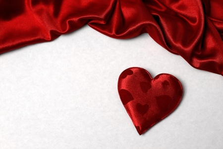 background with a heart shape and silk