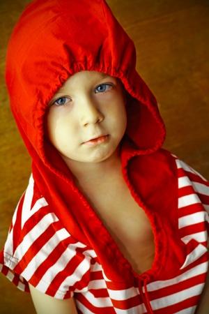 period costume: portrait of a boy in a strange hat