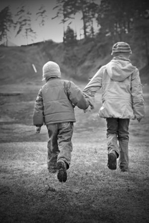 girl and boy standing or running on the road photo