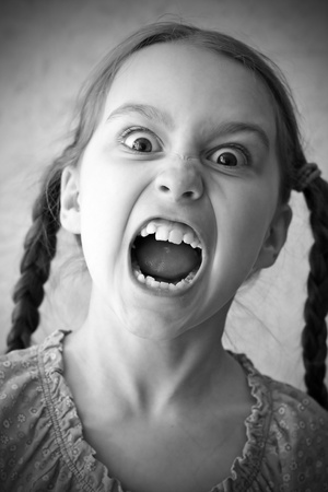 woman screaming: portrait of screaming girls with bulging eyes Stock Photo