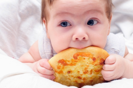 little kid eating pizza appetizing photo