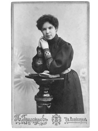 fashion photos: Vintage portrait of woman early 20 century on background.
