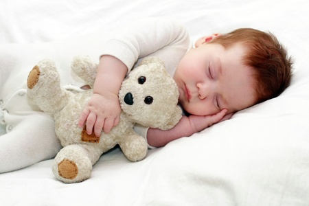 portrait of a close-up, infant lying on the bed photo