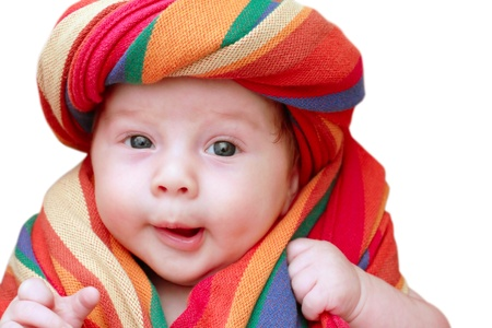 1 boy only: portrait of a smiling baby in a striped fabric