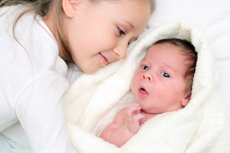 2 months: loving sister with little brother