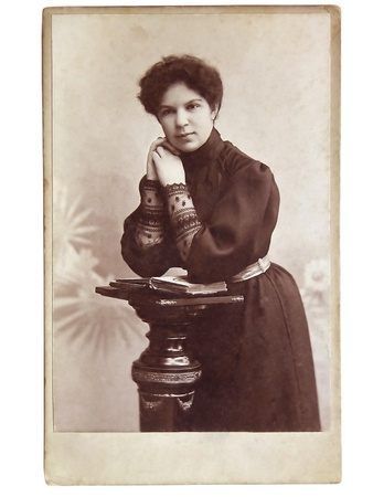 Vintage portrait of woman early 20 century on background.
