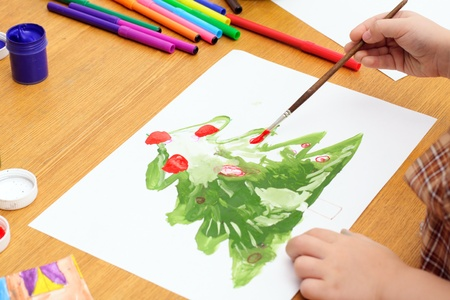 child draws a tree; hands, paint, markers Stock Photo - 10965742