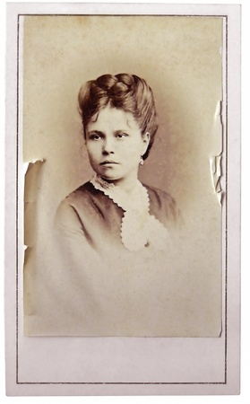 Vintage portrait of woman early 20 century on background. photo
