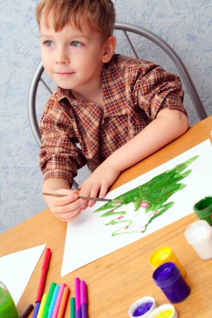 beautiful boys: boy paints a Christmas picture