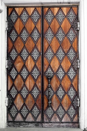 old door with patterns, closed, brown photo