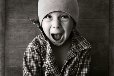 screaming head: boy in the hat shouted, black and white photography
