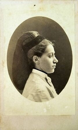 old photograph: Vintage portrait of woman early 20 century on background.