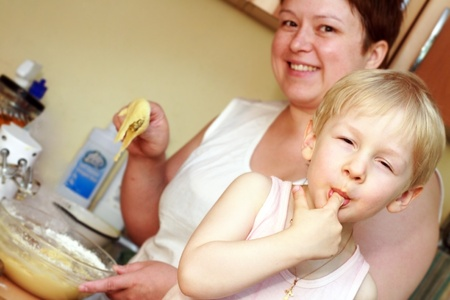 Mother and son preparing food, smiling photo