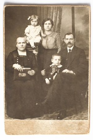 Old photo of family: husband, wife, children and the grandmother. Photo taken before 1917. photo