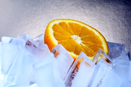 fresh orange is on the rocks photo