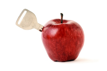 inserted: key is inserted into the fruit, apple Stock Photo