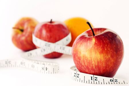 Photo of Fruit and Measuring Tape. photo