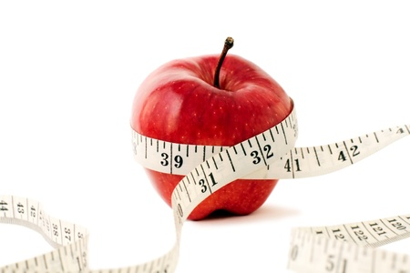 measure waist: Photo of Fruit and Measuring Tape.