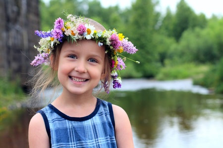 girl in the wreath with a bouquet of daisies photo