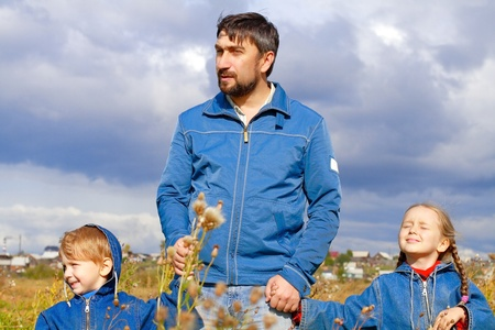 Father, son and daughter dressed in jeans Stock Photo - 11020654