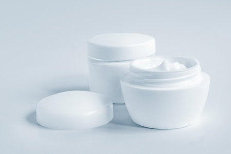 Containers of a different cosmetic creams. Close-up of a face cream. photo