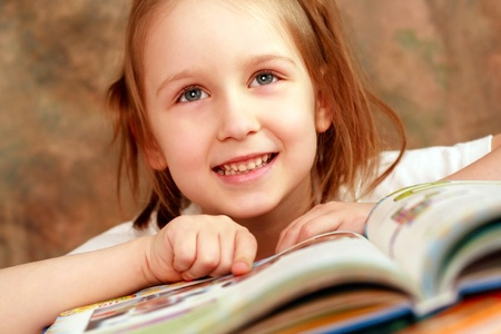 Smart girl reading a book and learns photo
