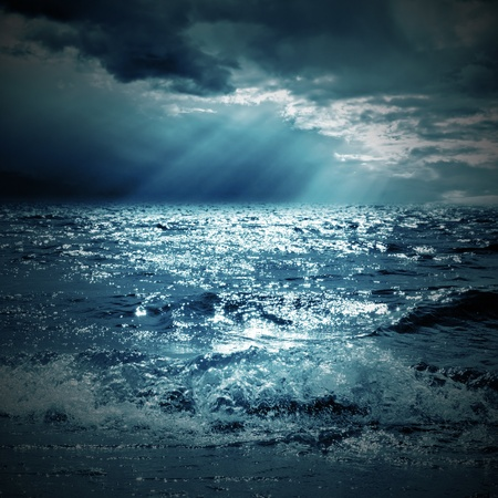 storm sea: a ray of sunshine on the sea