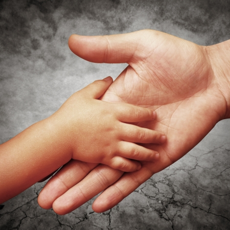 hand holds the hand of his father s son Stock Photo
