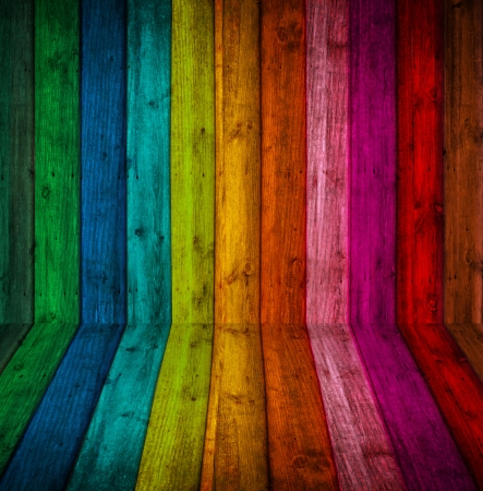 room is made   of wood, with bright colored paint