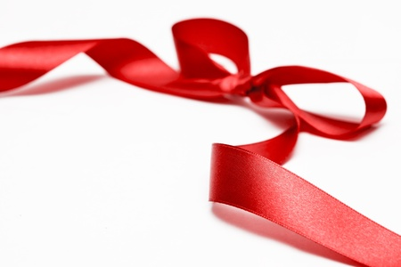 Shiny red satin ribbon on white background Standard-Bild