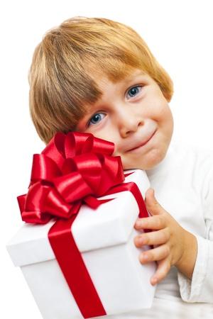 Smiling Boy holding present box isolated on white Stock Photo