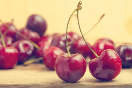 sour cherry: fresh red cherries on a wooden table
