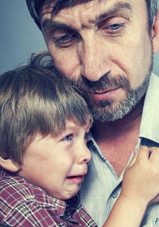 children sad: father with his young boy son Stock Photo