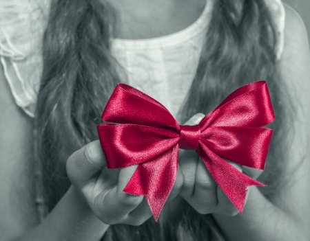 girl's hands holding christmas gift photo