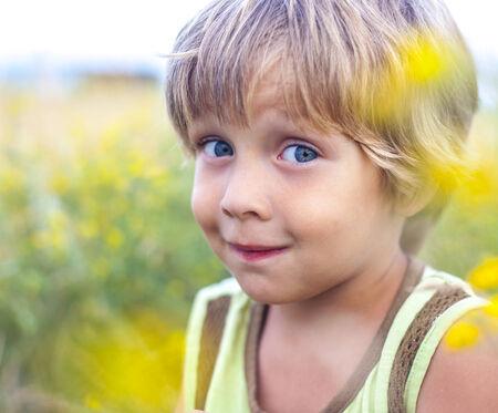 little boy in flowers field photo