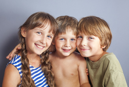 Beautiful portrait of two brothers and a sister