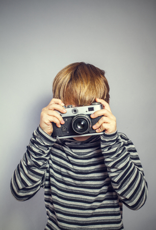 handsome boy with an old camera