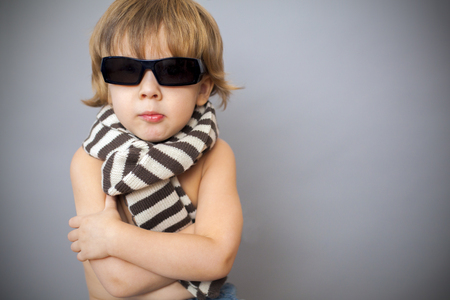 boy in sunglasses and striped scarf photo