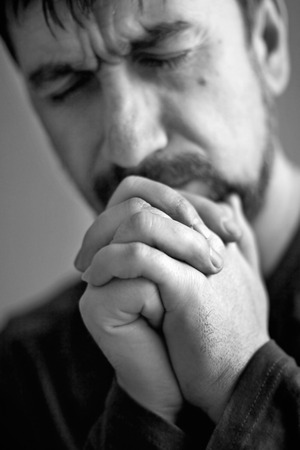 to implore: man closed his eyes to pray Stock Photo