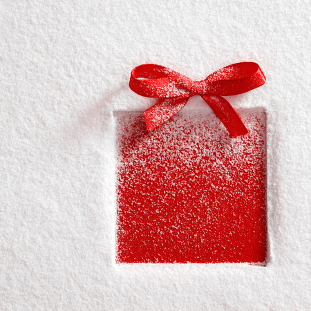gift with a bow on snow background photo
