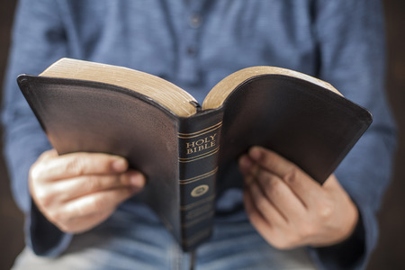 worship hands: Man reading from the holy bible, close up Stock Photo